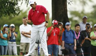 Gavin Green of Malaysia reacts after putt at 15th hole during the four-ball matches of the 2018 EurAsia Cup golf tournament at Glenmarie Golf & Country Club in Shah Alam, Malaysia, Friday, Jan. 12, 2018. (AP Photo/Sadiq Asyraf)