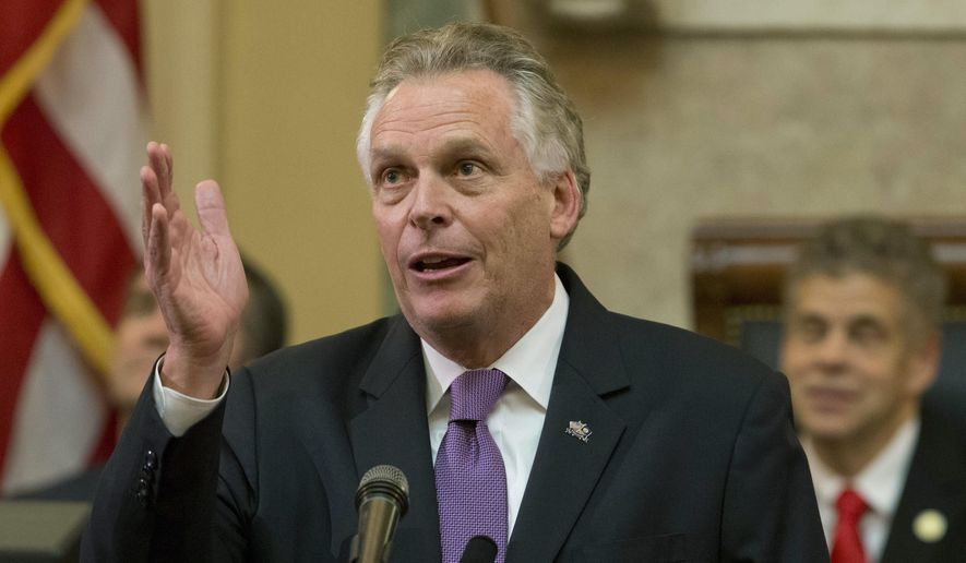 In this Jan. 10, 2018, file photo, then-Virginia Gov. Terry McAuliffe gestures as he addresses a joint session of the the 2018 session in the House chambers at the Capitol in Richmond, Va. (AP Photo/Steve Helber, File)