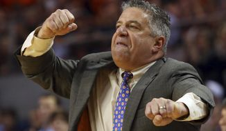 Auburn coach Bruce Pearl reacts to a call during the second half of the team's NCAA college basketball game against Mississippi on Tuesday, Jan. 9, 2018, in Auburn, Ala. Auburn won 85-70. (AP Photo/Butch Dill)