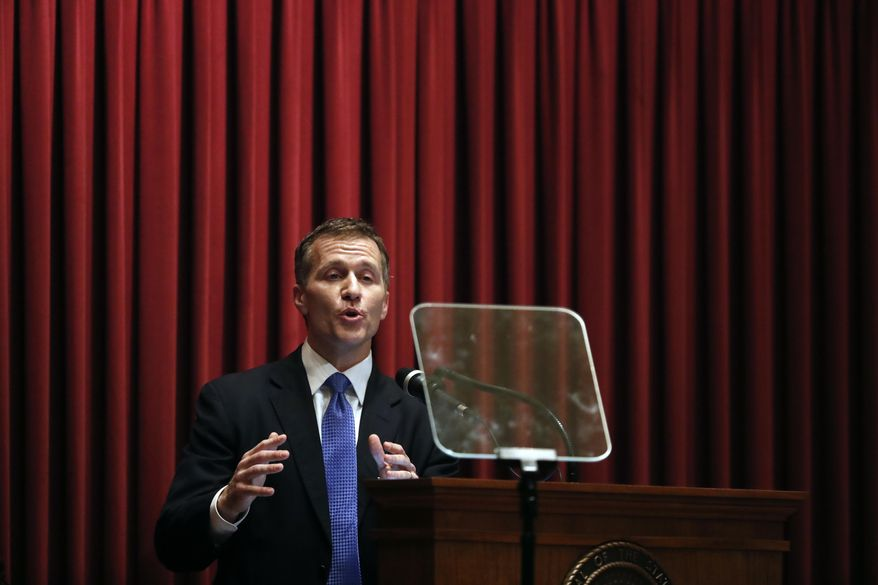 FILE - In this Wednesday, Jan. 10, 2018 file photo, Missouri Gov. Eric Greitens delivers the annual State of the State address to a joint session of the House and Senate, in Jefferson City, Mo. Greitens appears to be bracing for a fight to preserve his political life after admitting to an extramarital affair but denying anything more. Greitens met Thursday with Cabinet members and placed calls to rally support while his attorney issued firm denials to a smattering of allegations related to the affair. (AP Photo/Jeff Roberson, File)