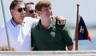 FILE - In this July 15, 2011 file photo, former U.S. Sen. John Tunney, left, stands with his arm around Patrick Kennedy on a pier in Hyannis Port, Mass., before Kennedy was to wed Amy Petitgout at the Kennedy Compound in Hyannis Port later in the day. John Tunney, the former U.S. senator from California, has died. His brother Jay Tunney says John Tunney died Friday, Jan. 12, 2018 in Santa Monica, Calif., of cancer. He was 83. John Tunney was the son of heavyweight boxing champion Gene Tunney, and was among the youngest people elected to the U.S. Senate in the past century when he won his seat in 1970 at age 36. (AP Photo/Michael Dwyer, File)