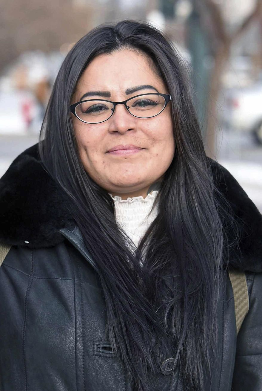 FILE - In this Dec. 8, 2017, file photo, Red Fawn Fallis, of Denver, stands outside the federal courthouse in Bismarck, N.D. Fallis, accused of shooting at law officers in October 2016 during protests in North Dakota against the Dakota Access oil pipeline, will not receive more information about an FBI informant she alleges seduced her and owned the gun. She is to stand trial in federal court in Fargo beginning Jan. 29, 2018. No one was injured in the shooting, (Tom Stromme /The Bismarck Tribune via AP, File)