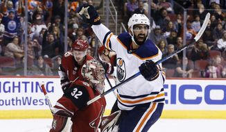 Edmonton Oilers left wing Jujhar Khaira, right, celebrates a goal by Oilers defenseman Darnell Nurse against Arizona Coyotes goaltender Antti Raanta (32) as Coyotes defenseman Oliver Ekman-Larsson (23) looks on during the first period of an NHL hockey game, Friday, Jan. 12, 2018, in Glendale, Ariz. (AP Photo/Ross D. Franklin)