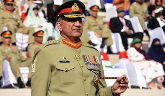 FILE -- In this Nov. 29, 2016 file photo released by Inter Services Public Relations, the public relations arm of the Pakistani army, Pakistani Army Chief Gen. Qamar Javed Bajwa attends the Change of Command ceremony in Rawalpindi, Pakistan. Bajwa says he received a phone call from the head of U.S. Central Command, Gen. Joseph Vogel, offering assurances that the United States would not unilaterally hit targets inside Pakistan. (Inter Services Public Relations via AP)