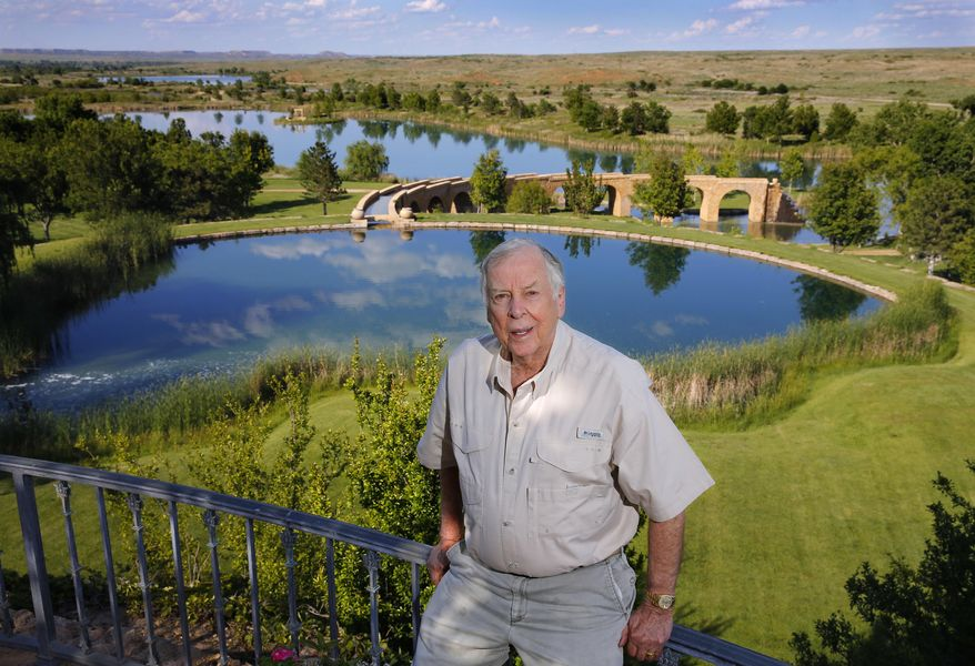 """FILE - In this May 30, 2017, file photo, oil tycoon T. Boone Pickens poses for a photo before a series of man-made lakes leading from The Lake House to The Lodge on his Mesa Vista Ranch in the panhandle of Texas. Pickens announced Friday, Jan. 12, 2018, that he is closing his Dallas energy-focused hedge fund. In a statement published on LinkedIn, the 89-year-old Pickens says that """"it's no secret the past year has not been good to me, from a health perspective or a financial one."""" (Tom Fox/The Dallas Morning News via AP, File)"""
