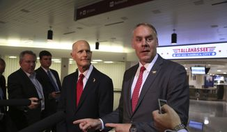 Florida Gov. Rick Scott and U.S. Department of the Interior Secretary Ryan Zinke, announce there will be no new offshore drilling in the State of Florida. Both met at the Tallahassee International Airport, Tuesday, Jan. 9, 2018. (Scott Keeler/Tampa Bay Times via AP)