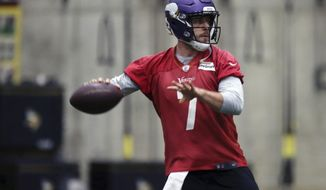 In this Jan. 11, 2018, photo, Minnesota Vikings NFL quarterback Case Keenum looks to throw a pass during football practice warmups in Eden Prairie, Minn. Lightly recruited out of high school and undrafted out of college, Keenum has kept on proving perceptions about a 6-foot-1 quarterback wrong. Once a career backup, Keenum has quickly become perhaps the NFL's best success story of 2017 by taking over for the Minnesota Vikings and leading them within two wins of playing the Super Bowl on home turf. (AP Photo/Jim Mone)