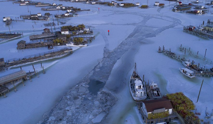This Sunday Jan. 7, 2018 photo provided by Jay Fleming shows the ice covered Tangier channel in Tangier Island, Va. Annapolis photographer Fleming thought he'd get a few shots on Tangier Island and be on his way back home. Instead, he found himself stuck on the ice-locked 1.2-square-mile Tangier in the middle of a National Guard emergency supply drop and the island's old ice tradition. (Jay Fleming via AP)