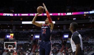 Washington Wizards forward Otto Porter Jr. (22) shoots the ball during the overtime portion of an NBA basketball game against the Brooklyn Nets, Saturday, Jan. 13, 2018, in Washington. The Wizards won 119-113 in overtime. (AP Photo/Alex Brandon) **FILE**