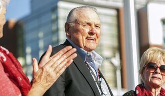 FILE - In this Sept. 13, 2014, file photo, Washington State alumnus Keith Jackson smiles after raising the Cougar flag before the start of an NCAA college football game against Portland State at Martin Stadium in Pullman, Wash. Jackson, the down-home voice of college football during more than five decades as a broadcaster, died Friday, Jan. 12, 2018. He was 89.  (AP Photo/Dean Hare, File)