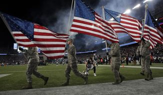 New England Patriots wide receiver Danny Amendola (80) kneels as members of the United States military carry American flags on the field before an NFL divisional playoff football game between the Patriots and the Tennessee Titans, Saturday, Jan. 13, 2018, in Foxborough, Mass. (AP Photo/Charles Krupa)