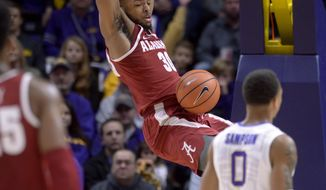 Alabama forward Galin Smith (30) dunks against LSU during the first half of an NCAA college basketball game Saturday, Jan. 13, 2018, in Baton Rouge, La. (Hilary Scheinuk/The Advocate via AP)