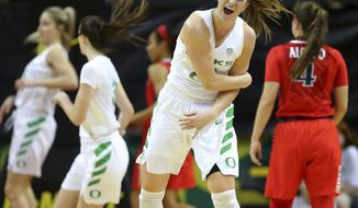 Oregon's Sabrina Ionescu celebrates the first of her four 3-pointers against Arizona during an NCAA college basketball game in Eugene, Ore., Friday, Jan. 12, 2018. (Brian Davies/The Register-Guard via AP)