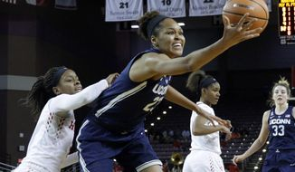 Connecticut forward Azura Stevens (23) pulls in a rebound in front of Houston forward Octavia Barnes (2) during the first half of an NCAA college basketball game Saturday, Jan. 13, 2018, in Houston, Texas. (AP Photo/Michael Wyke)