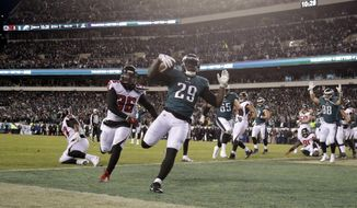 Philadelphia Eagles' LeGarrette Blount scores a touchdown during the first half of an NFL divisional playoff football game against the Atlanta Falcons, Saturday, Jan. 13, 2018, in Philadelphia. (AP Photo/Michael Perez)