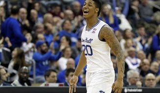 Seton Hall forward Desi Rodriguez reacts after making a 3-point basket against Georgetown during the first half of an NCAA college basketball game, on Saturday, Jan. 13, 2018, in Newark, N.J. (AP Photo/Adam Hunger)