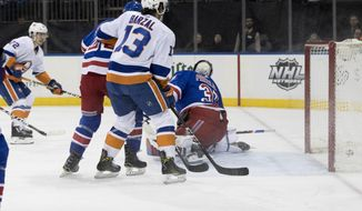 New York Islanders center Anthony Beauvillier (72) scores a goal past New York Rangers goaltender Ondrej Pavelec (31) during the first period of an NHL hockey game, Saturday, Jan. 13, 2018, at Madison Square Garden in New York. (AP Photo/Mary Altaffer)