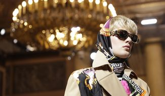 A model wears a creation as part of Versace men's Fall-Winter 2018-19 collection, that was presented in Milan, Italy, Saturday, Jan.13, 2018. (AP Photo/Luca Bruno)