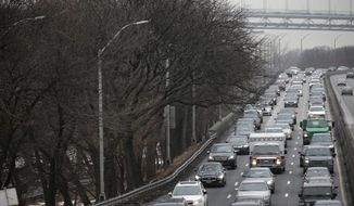 In this Jan, 11, 2018, photo, traffic moves slowly toward downtown Manhattan on the West Side Highway in New York. A proposal to make part of Manhattan a toll zone, where drivers would be charged to drive into the most congested neighborhoods, is gaining momentum, despite continuing criticism from lawmakers representing car-heavy parts of Brooklyn and Queens. (AP Photo/Seth Wenig)