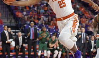 Clemson's Aamir Simms saves an out of bounds shot during the first half of an NCAA college basketball game against Miami Saturday, Jan. 13, 2018, in Clemson, S.C. (AP Photo/Richard Shiro)