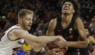 Arizona State guard Kodi Justice (44) ties up the ball with Oregon State guard Ethan Thompson during the first half of an NCAA college basketball game, Saturday, Jan. 13, 2018, in Tempe, Ariz. (AP Photo/Rick Scuteri)