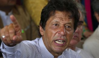 "FILE - In this July 28, 2017 file photo, Pakistani opposition leader Imran Khan gestures during a news conference in Islamabad, Pakistan. Khan said Saturday, Jan. 13, 2018 that meeting U.S. President Donald Trump would be a ""bitter pill"" to swallow should he become Pakistan's prime minister in elections later this year, but added ""I would meet him."" (AP Photo/Anjum Naveed, File)"