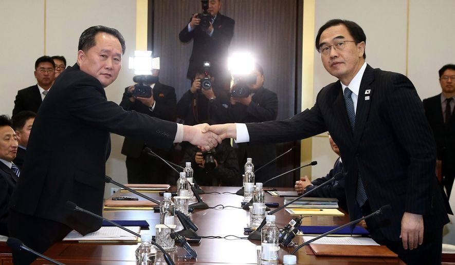 FILE - In this Tuesday, Jan. 9, 2018, file photo, South Korean Unification Minister Cho Myoung-gyon, right, shakes hands with the head of North Korean delegation Ri Son Gwon during their meeting at the Panmunjom in the Demilitarized Zone in Paju, South Korea. South Korea said Saturday that North Korea proposed that their talks next week address a North Korean art troupe's visit to the Pyeongchang Winter Olympics in the South, rather than the participation of the nation's athletes. (Korea Pool via AP)
