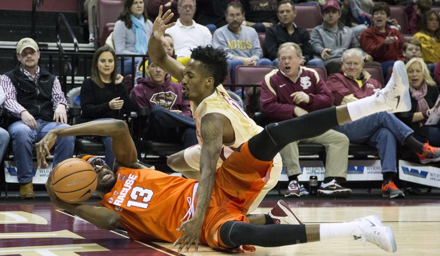 Florida State guard Braian Angola harasses Syracuse's Paschal Chukwu in the second half of an NCAA college basketball game in Tallahassee, Fla., Saturday, Jan. 13, 2018. Florida State defeated Syracuse 101-90 in double overtime. (AP Photo/Mark Wallheiser)
