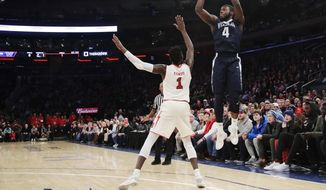 Villanova's Eric Paschall (4) shoots over St. John's Bashir Ahmed (1) during the first half of an NCAA college basketball game Saturday, Jan. 13, 2018, in New York. (AP Photo/Frank Franklin II)