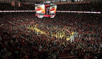 Texas Tech fans celebrate on the court after the second half of an NCAA college basketball game against West Virginia, Saturday, Jan. 13, 2018, in Lubbock, Texas. (AP Photo/Brad Tollefson)