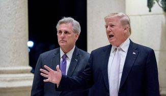 """I'm not a racist. I'm the least racist person you will ever interview,"" said President Trump told reporters as he met with House Majority Leader Kevin McCarthy, California Republican (left). The furor grew out of an immigration discussion at the White House on Thursday where Mr. Trump allegedly made vulgar comments. (Associated Press)"