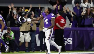 CORRECTS SPELLING TO DIGGS NOT RIGGS Minnesota Vikings wide receiver Stefon Diggs (14) celebrates in the end zone after a game winning touchdown against the New Orleans Saints during the second half of an NFL divisional football playoff game in Minneapolis, Sunday, Jan. 14, 2018. The Vikings defeated the Saints 29-24. (AP Photo/Jeff Roberson)