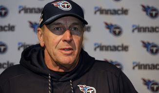 Tennessee Titans head coach Mike Mularkey speaks to the media following an NFL divisional playoff football game against the New England Patriots, Sunday, Jan. 14, 2018, in Foxborough, Mass. (AP Photo/Steven Senne)