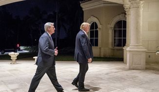 President Donald Trump, right, and House Majority Leader Kevin McCarthy, R-Calif., arrive for a dinner at Trump International Golf Club in West Palm Beach, Fla., Sunday, Jan. 14, 2018. (AP Photo/Andrew Harnik)