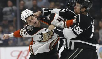 Los Angeles Kings defenseman Kurtis MacDermid, right, fights with Anaheim Ducks right wing Jared Boll during the first period of an NHL hockey game in Los Angeles, Saturday, Jan. 13, 2018. (AP Photo/Alex Gallardo)