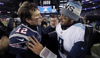 New England Patriots quarterback Tom Brady, left, and Tennessee Titans quarterback Marcus Mariota speak at midfield after an NFL divisional playoff football game, Saturday, Jan. 13, 2018, in Foxborough, Mass. (AP Photo/Steven Senne)