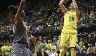 Oregon's Sabrina Ionescu, right, shoots over Arizona State's Sophia Elenga during the first half of their NCAA basketball game in Eugene, Ore. Sunday Jan. 14. 2018. (Chris Pietsch/The Register-Guard via AP)