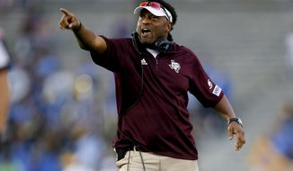 FILE - In this Sunday, Sept. 3, 2017, file photo, Texas A&M head coach Kevin Sumlin gestures during an NCAA college football game against UCLA, in Pasadena, Calif. A person familiar with the decision says Arizona will hire former Texas A&M coach Sumlin. The person spoke to The Associated Press on Sunday, Jan. 14, 2018, on condition of anonymity because details of a five-year contract to replace Rich Rodriguez as coach of the Wildcats were still being finalized. (AP Photo/Danny Moloshok, File)
