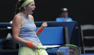 Latvia's Jelena Ostapenko celebrates a point win over Francesca Schiavone of Italy during their first round match at the Australian Open tennis championships in Melbourne, Australia, Monday, Jan. 15, 2018. (AP Photo/Vincent Thian)
