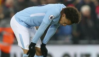 Manchester City's Leroy Sane reacts at the end of the English Premier League soccer match between Liverpool and Manchester City at Anfield Stadium, in Liverpool, England, Sunday Jan. 14, 2018. (AP Photo/Dave Thompson)