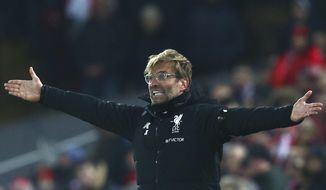 Liverpool's manager Juergen Klopp gestures during the English Premier League soccer match between Liverpool and Manchester City at Anfield Stadium, in Liverpool, England, Sunday Jan. 14, 2018. (AP Photo/Dave Thompson)