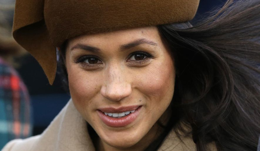 In this file photo dated Monday, Dec. 25, 2017, Meghan Markle fiancee of Prince Harry walks with members of the British Royal family for the traditional Christmas Day church service, at St. Mary Magdalene Church in Sandringham, England.  The U.K. Independence Party has suspended the membership of Jo Marney, the girlfriend of the party's leader, Sunday Jan. 14, 2018, after she reportedly made racist remarks about Markle.(AP Photo/Alastair Grant, FILE)