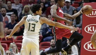 Miami Heat's Josh Richardson, right, passes as Milwaukee Bucks' Malcolm Brogdon (13) defends during the first half of an NBA basketball game, Sunday, Jan. 14, 2018, in Miami. (AP Photo/Lynne Sladky)