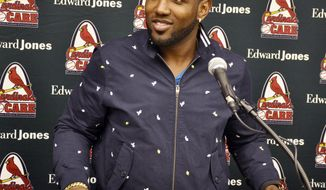 "St. Louis Cardinals outfielder Marcell Ozuna answers a question during a news conference at the team's annual ""Winter Warm-Up"" on Sunday, Jan. 14, 2018, in St. Louis. Ozuna was traded to the Cardinals from the Miami Marlins last month, and the All-Star outfielder is expected to have an immediate impact in the St. Louis lineup. (AP Photo/Kurt Voigt)"