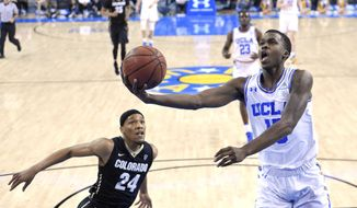 UCLA guard Kris Wilkes, right, shoots as Colorado guard George King defends during the first half of an NCAA college basketball game Saturday, Jan. 13, 2018, in Los Angeles. (AP Photo/Mark J. Terrill)