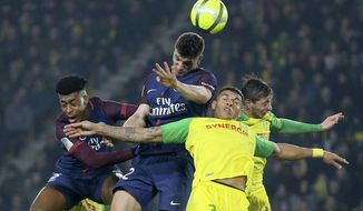 PSG's Thomas Meunier jumps for a header with Nantes' defender Diego Carlos during their French League One soccer match, in Nantes, western France, Sunday, Jan. 14, 2018. (AP Photo/David Vincent)