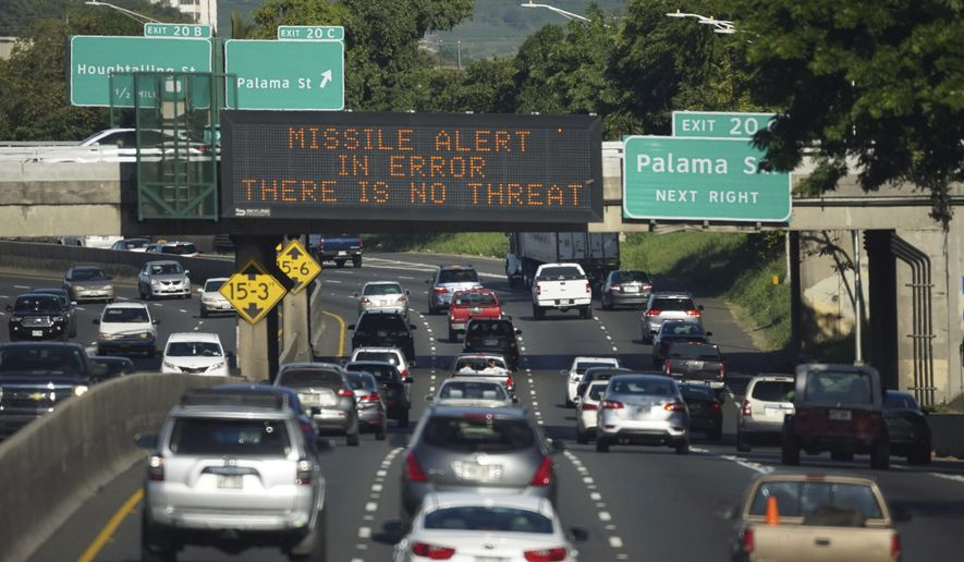 "In this Saturday, Jan. 13, 2018 photo provided by Civil Beat, cars drive past a highway sign that says ""MISSILE ALERT ERROR THERE IS NO THREAT"" on the H-1 Freeway in Honolulu. The state emergency officials announced human error as cause for a statewide announcement of an incoming missile strike alert that was sent to mobile phones. (Anthony Quintano/Civil Beat via AP)"