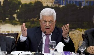 Palestinian President Mahmoud Abbas, speaks during a meeting with the Palestinian Central Council, a top decision-making body, at his headquarters in the West Bank city of Ramallah, Sunday, Jan. 14, 2018. (AP Photo/Majdi Mohammed,l)