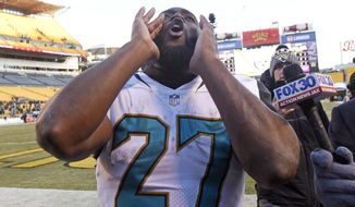 Jacksonville Jaguars running back Leonard Fournette (27) celebrates as he walks off the field following a 45-42 win over the Pittsburgh Steelers in an NFL divisional football AFC playoff game in Pittsburgh, Sunday, Jan. 14, 2018. (AP Photo/Don Wright)