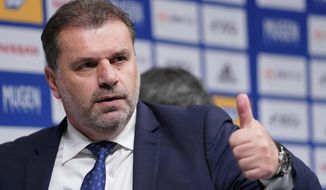 Yokohama F Marinos new head coach Ange Postecoglou of Australia gives a thumbs up after a press conference in Yokohama, near Tokyo, Sunday, Jan. 14, 2018. Former Australia coach Postecoglou was introduced as head coach of the J-League's Yokohama F. Marinos on Sunday. (AP Photo/Shizuo Kambayashi)